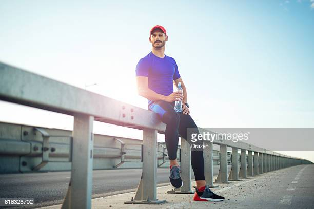 muscular athlete resting after training - circuit training stock photos and pictures