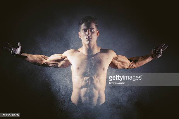 Muscular Athlete with Chalk Dust