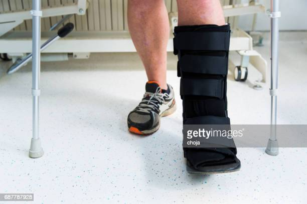 Muscular athlete with Walking boot for achilles tendon treatment