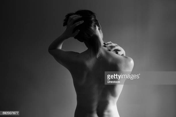 Muscular back of nude Caucasian woman