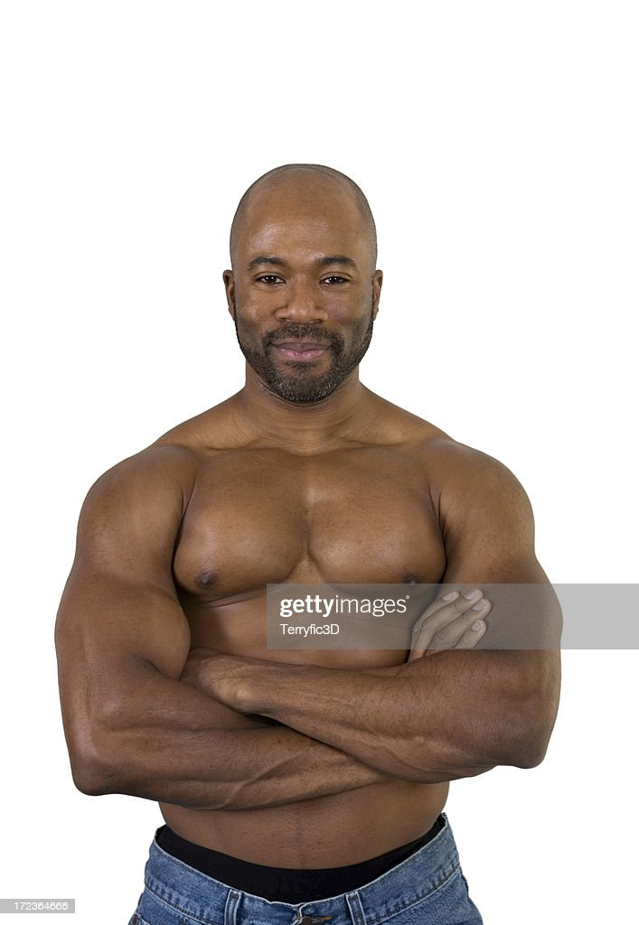 Muscular Black Man With Arms Crossed On Bare Chest Stock Photo