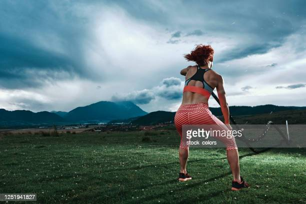 muscular build of sporty woman - female bodybuilder stock pictures, royalty-free photos & images