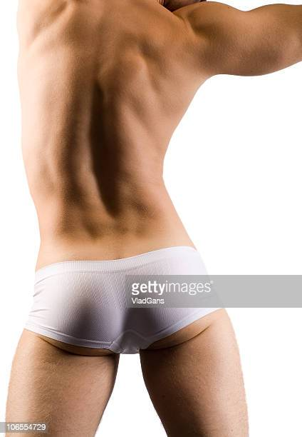 muscular male back in white shorts - beautiful bare bottoms stock pictures, royalty-free photos & images