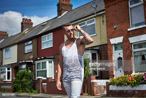 Muscular male stood in a residential street