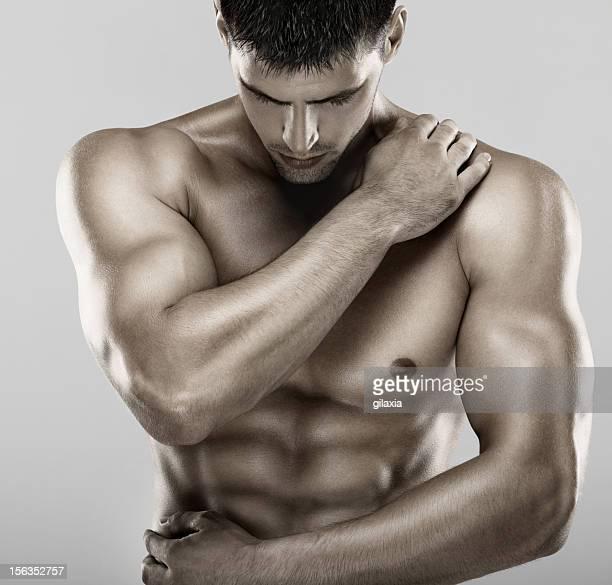 Muscular male upper body.
