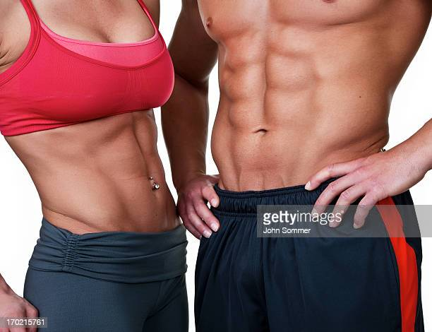 muscular man and woman - female bodybuilder stock pictures, royalty-free photos & images