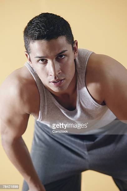 Muscular man bending forward