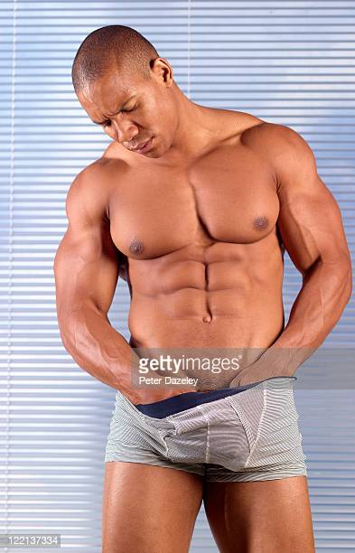 muscular man checking for testicular cancer