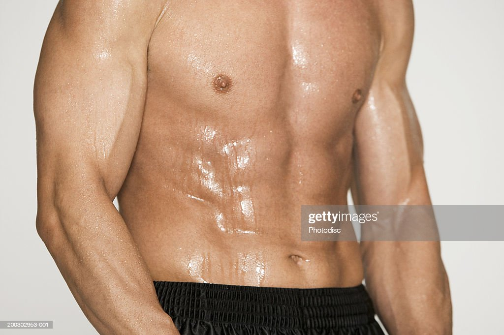 Muscular man, posing in studio, portrait, mid section : Stock Photo
