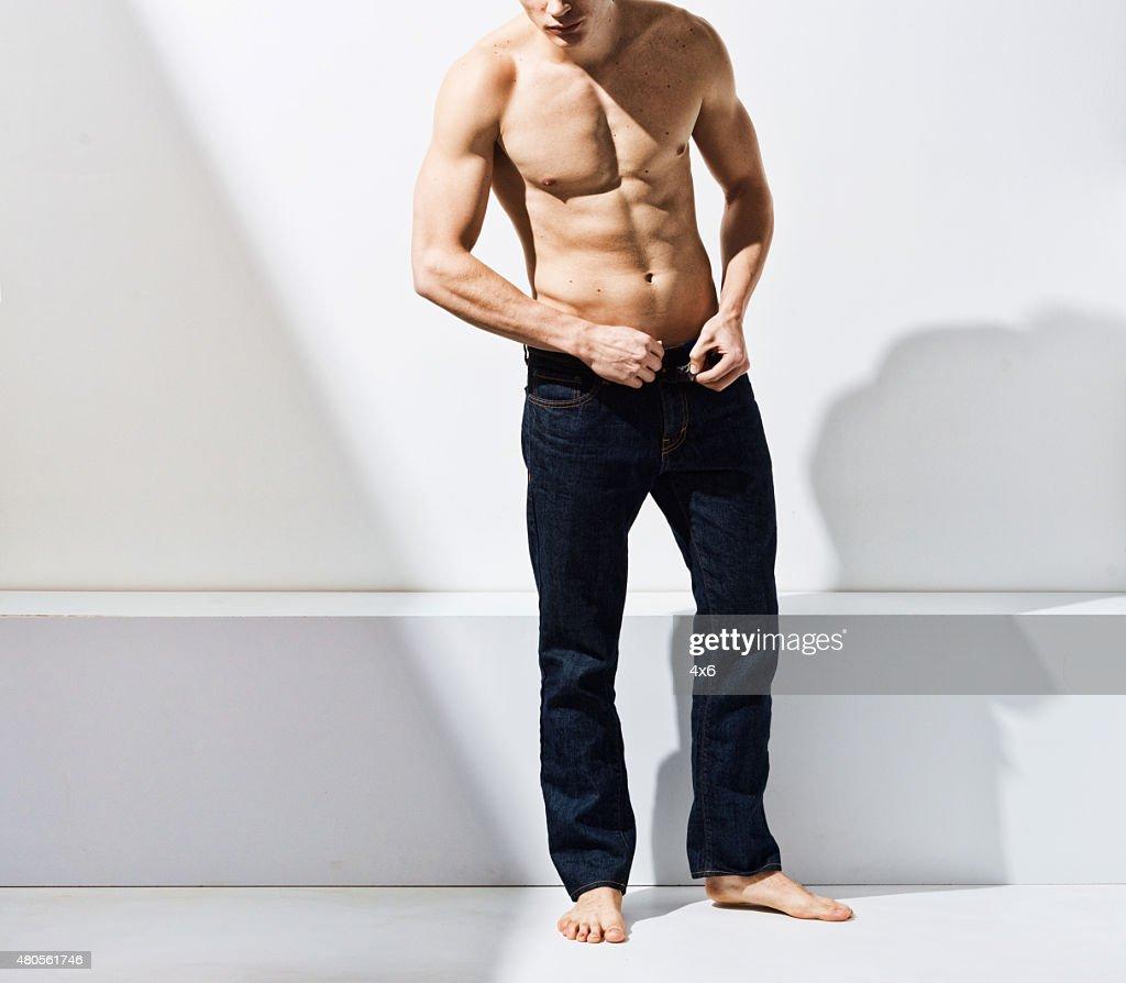 Muscular man posing : Stock Photo