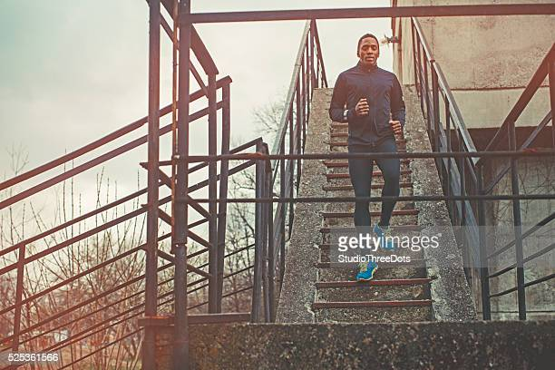 Muscular Man Running Up And Down The Stairs