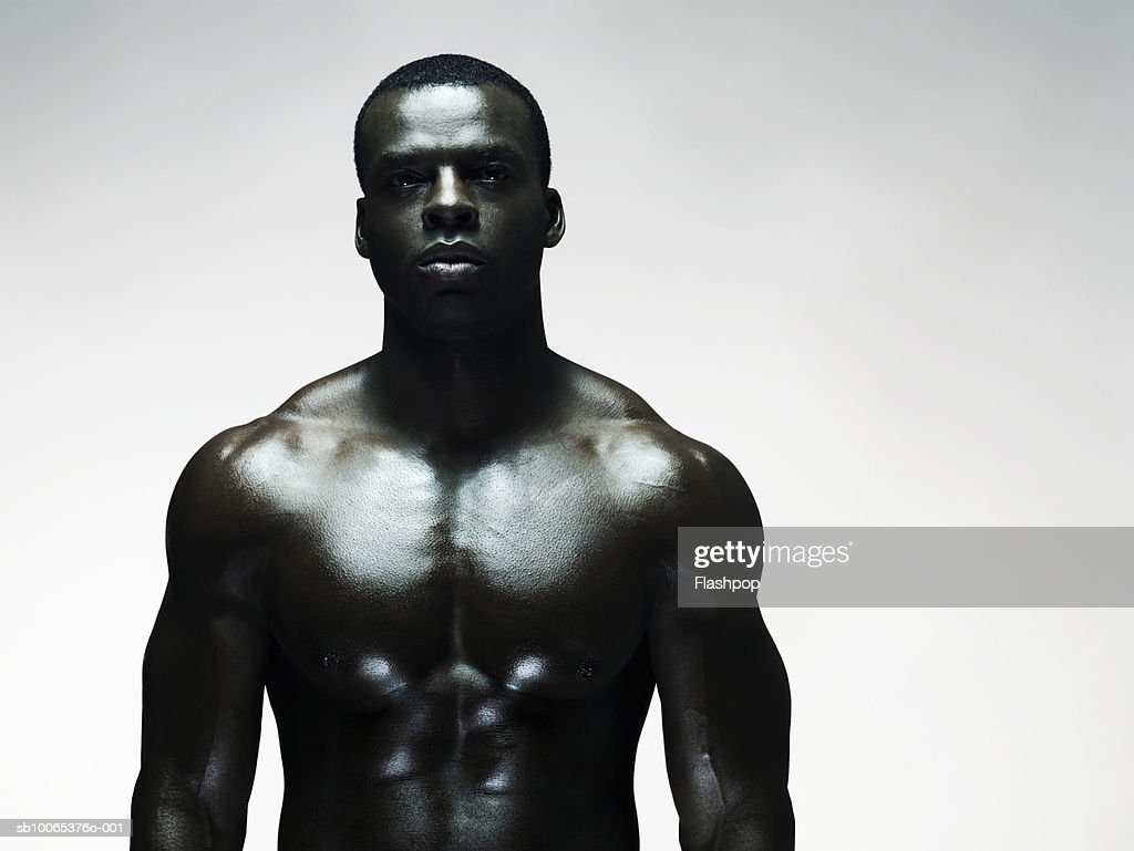 Muscular man standing, close-up : Foto stock