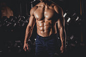 Muscular Man Standing In The Gym