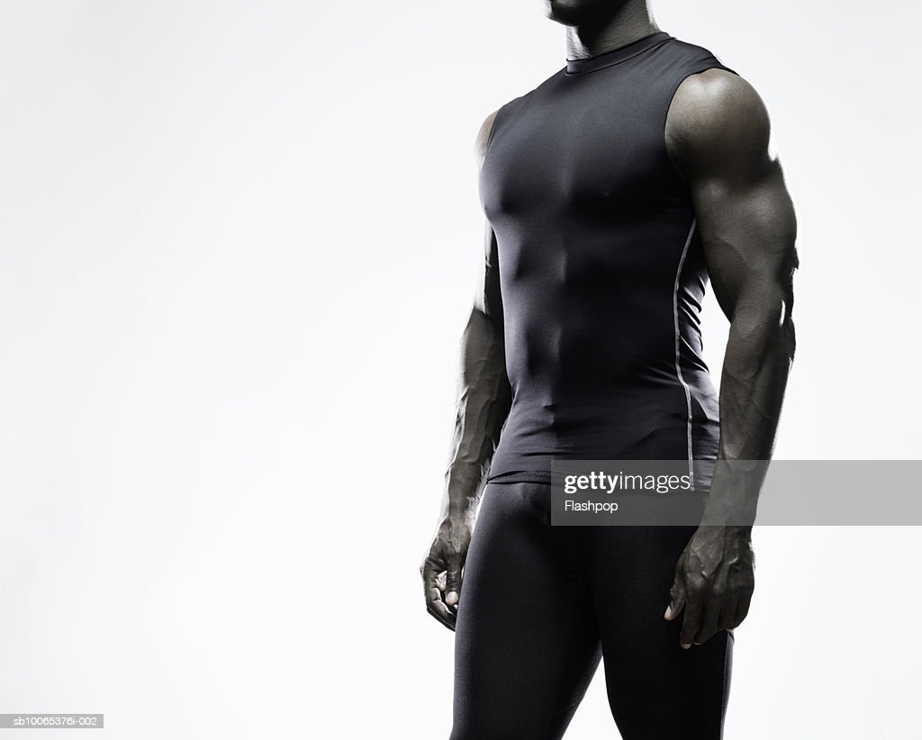 Muscular man standing, mid section : Foto stock