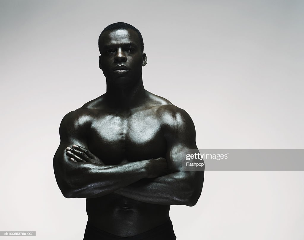 Muscular man standing with arms out, close-up : Foto stock