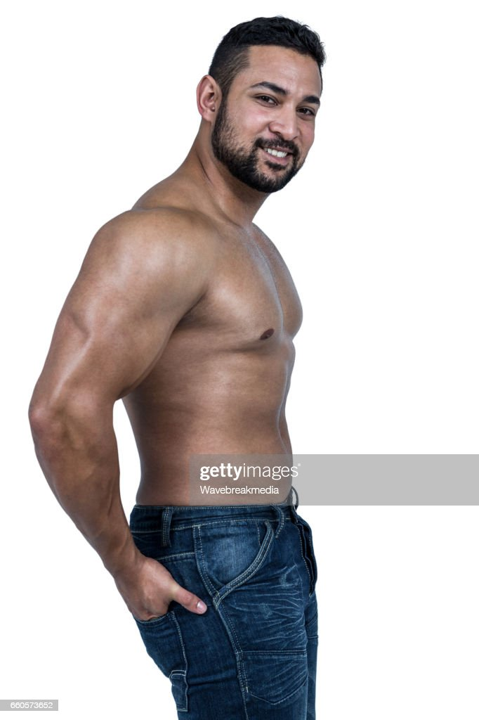 f79cb922 Muscular Man Wearing Blue Jeans Stock Photo - Getty Images