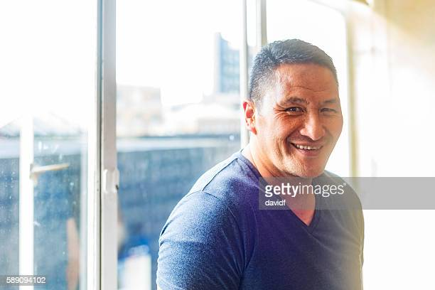 Muscular Maori Pacific Islander Man by a Window