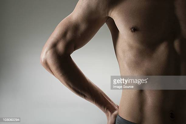 muscular mature man, front view - torso stock pictures, royalty-free photos & images