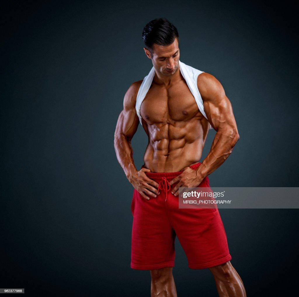 JUNE: Muscle men flexing