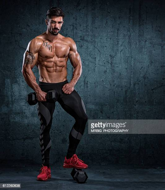 muscular men standing strong - handsome bodybuilders stock photos and pictures