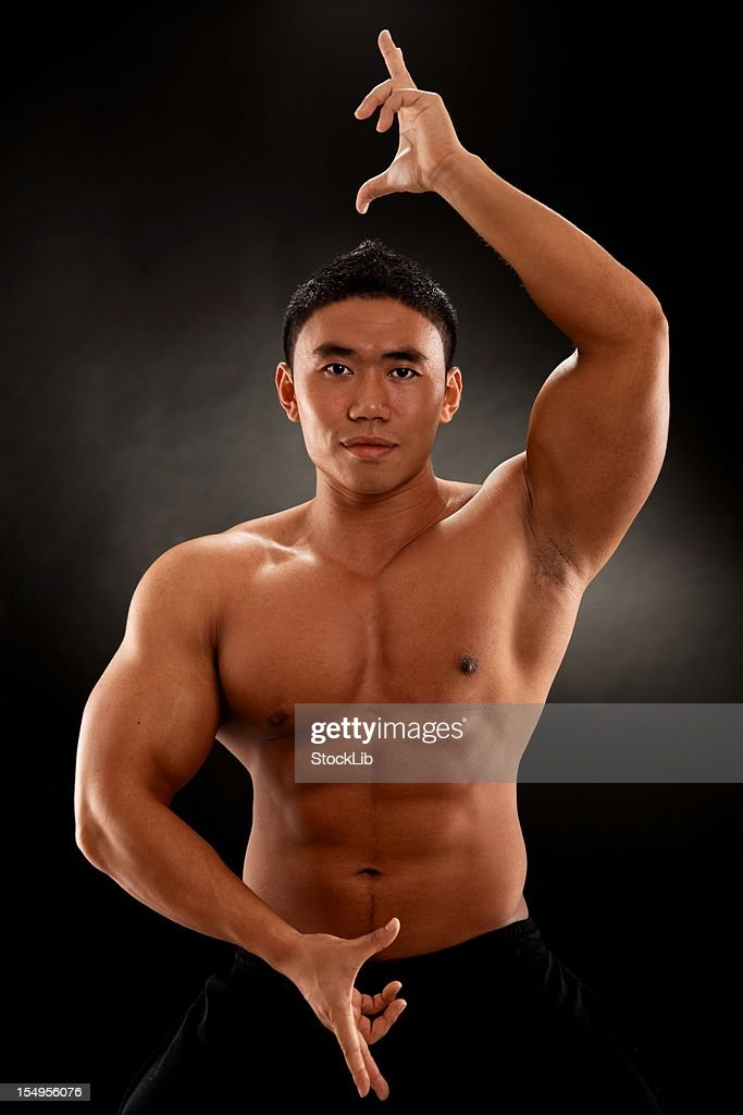 Muscular shirtless asian man posing : Stock Photo