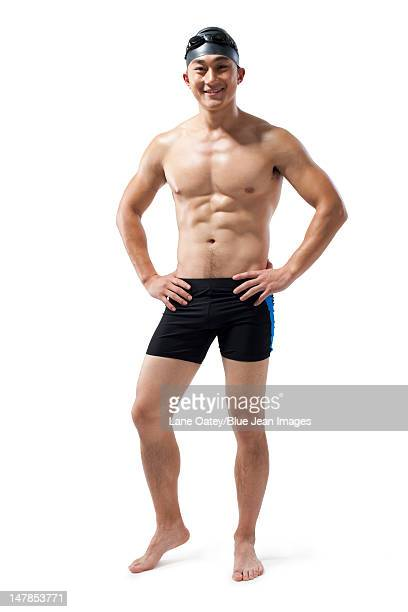 Muscular swimmer with hands on his hips