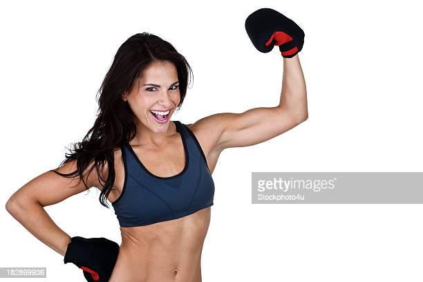 Muscular woman wearing boxing gloves