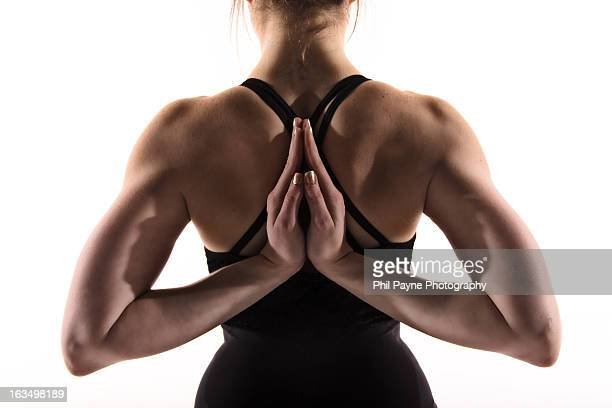 Muscular Woman's Back In Yoga Pose