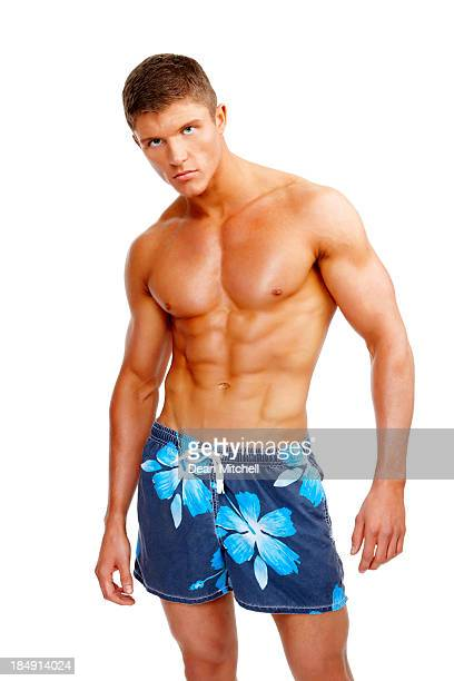 Muscular Young Man in Swimming Trunks