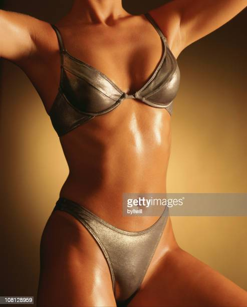 Muscular Young Woman Wearing Silver Swimsuit