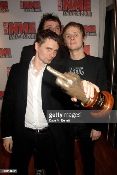 Muse band members pose in the awards room with the Best Live Band Award during the Shockwaves NME Awards 2008 at the 02 Arena on February 28 2008 in...