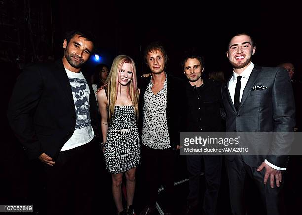 Muse media manager Tom Kirk with musicians Avril Lavigne Dominic Howard and Matthew Bellamy of Muse and Mike Posner backstage at the 2010 American...