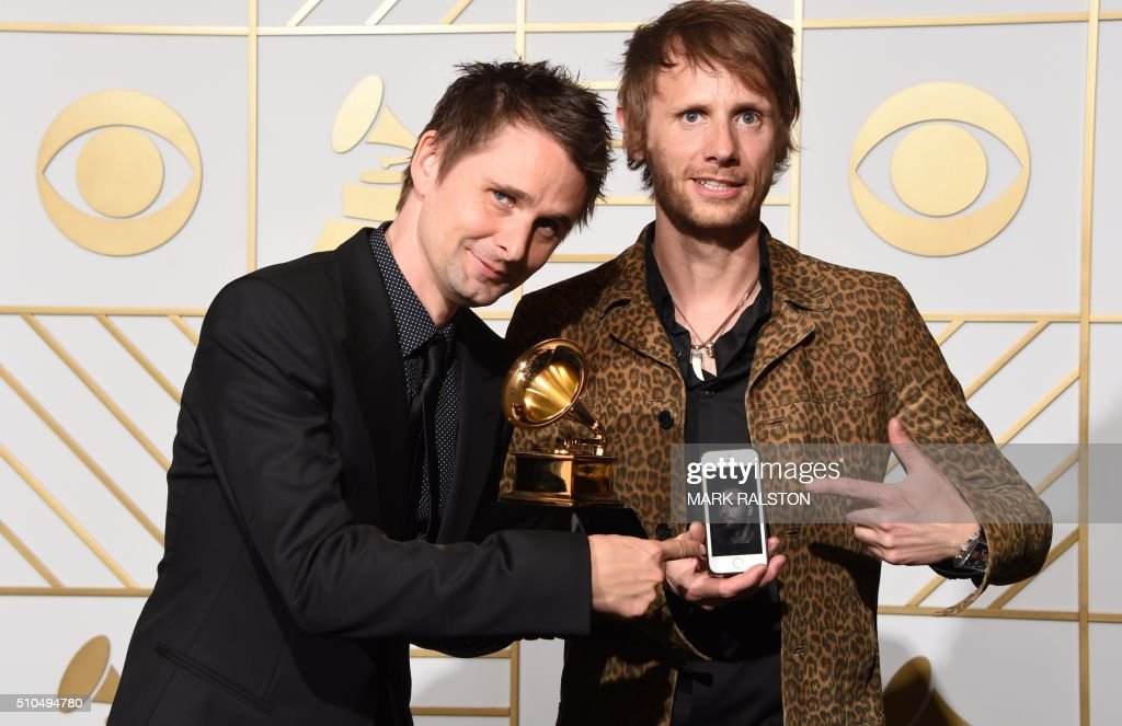 Muse pose in the press room with their Best Rock Album trophy for 'Drone' during the 58th Annual Grammy Music Awards in Los Angeles on February 15, 2016. AFP PHOTO / Mark RALSTON /