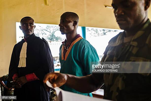 Musenu Tshilayi a Congolese Major Sergeant accused of rape and violation of instructions stands at the Military Tribunal of Kinshasa during the trial...