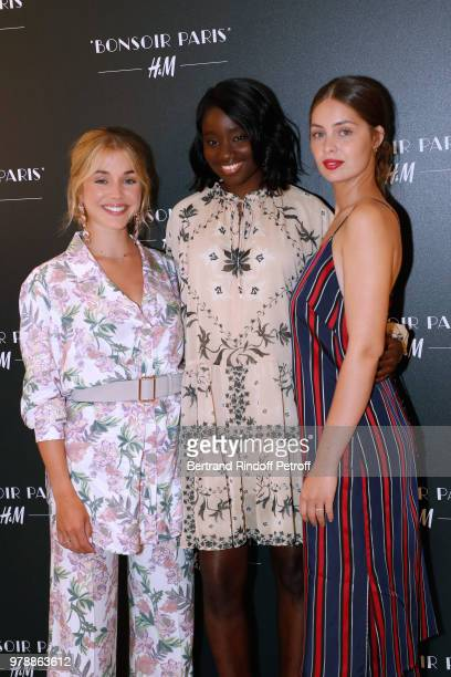 Muses of H&M Alice Isaaz, Karidja Toure and Marie-Ange Casta attend the H&M Flaship Opening Party as part of Paris Fashion Week on June 19, 2018 in...