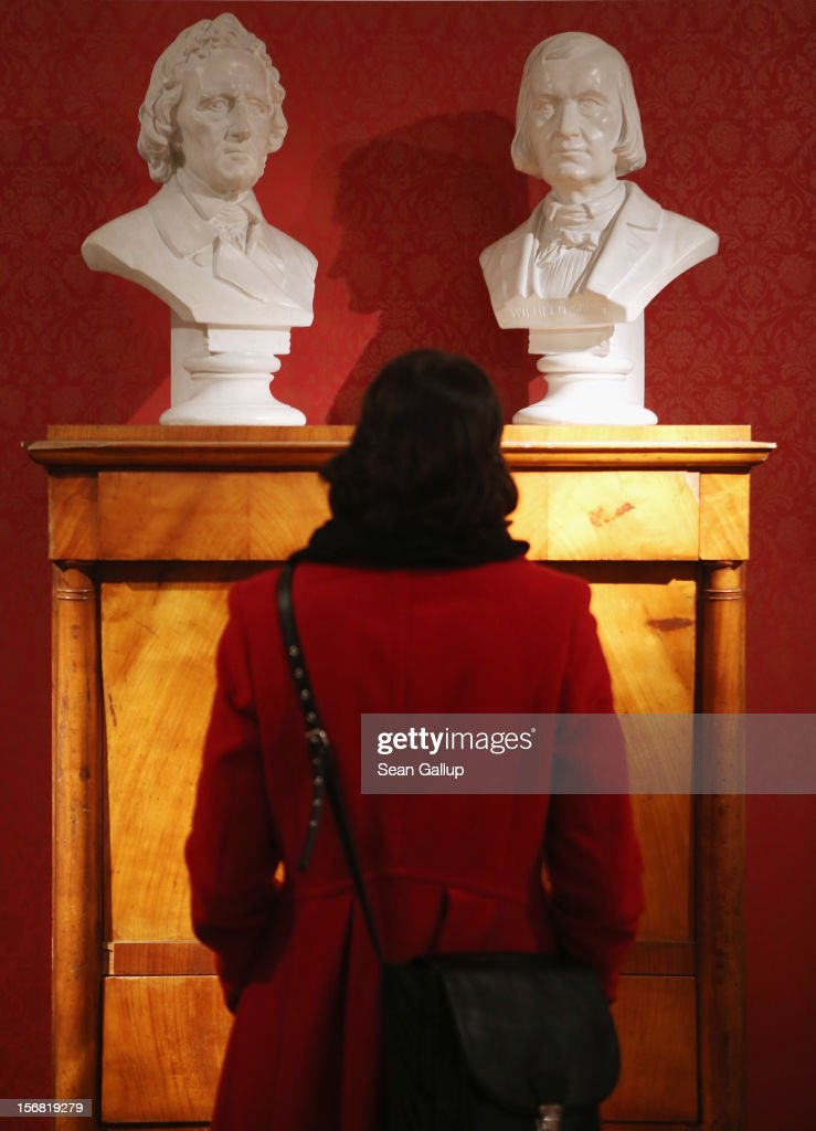 A museum administration employee, at the request of the photographer, looks at busts of brothers Jacob (L) and Wilhelm Grimm at the Grimm Brothers Museum on November 20, 2012 in Kassel, Germany.The 200th anniversary of the first publication of the fairy tales, which the brothers collected from oral traditions in the region between Frankfurt and Bremen in the early 19th century and include such global classics as Sleeping Beauty, Little Red Riding Hood, Rapunzel, Cinderella and Hansel and Gretel, will take place this coming December 20th.