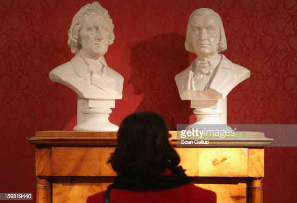 A museum administration employee at the request of the photographer looks at busts of brothers Jacob and Wilhelm Grimm at the Grimm Brothers Museum...