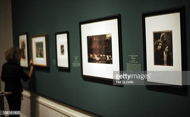 A museum artist puts the finishing touches on wall captions for the opening of The PreRaphaelite Lens British Photography and Painting 1848�1875 on...