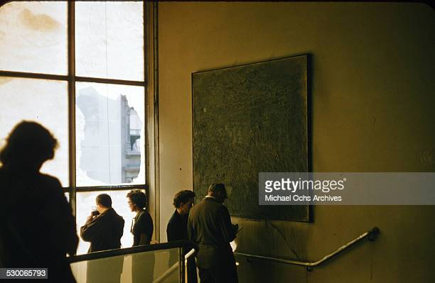 APRIL 151958 Museum curators assess the damage to the artwork after a fire broke out on the second floor of the Museum of Modern Art in New York NY