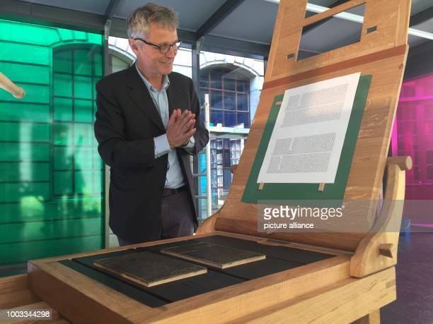 Museum director Gabriel de Montmollin with a replica Gutenberg printing press at the International Museum of the Reformation in Geneva Switzerland 29...