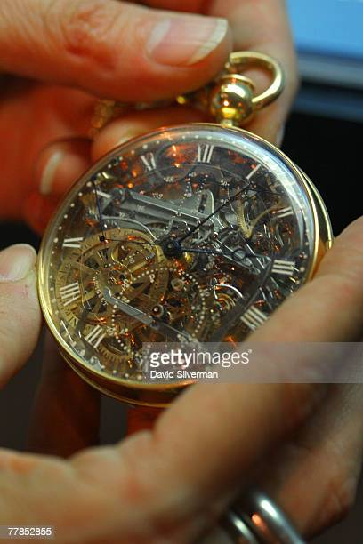 A museum employee displays the recently recovered gold and rockcrystal pocket watch made for the French queen Marie Antoinette at the L A Meyer...