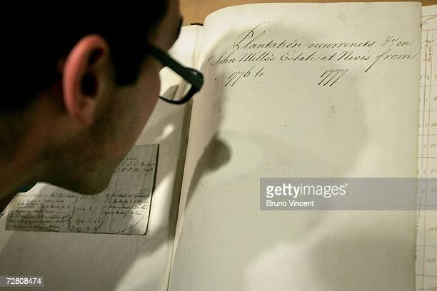 Museum employee examines the working papers of Thomas Mills and his son John Mills at the Museum in Docklands on December 12, 2006 in Canary Wharf,...