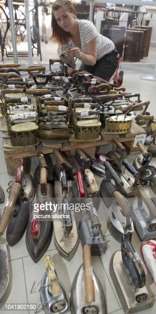 Museum employee SteffiBaum sorts irons in the new museum about the history of the iron in Zinnowitz,Germany, 09 July 2013. A new exhibition in...