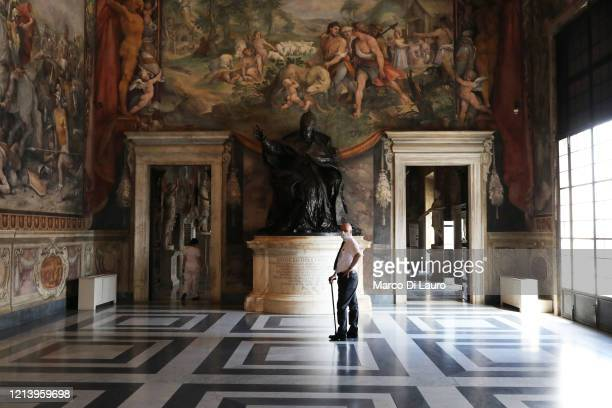 Museum employee wearing a face mask stands in one of the rooms of the Capitoline Museums on the first day of opening after more than two months of...