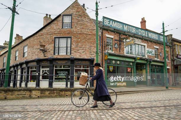 Museum Engager Alison Watson pushes her bicycle down the cobbled street at Beamish Museum as it prepares to re-open to the public on July 22, 2020 in...