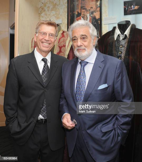Museum executive director Bob Santelli and Placido Domingo pose before A Conversation With Placido Domingo at The GRAMMY Museum on October 6 2013 in...