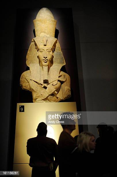 COOCTOBER 6TH 2010 Museum goers look at the Colossal Statue of Amenhotep IV at the King Tut exhibit at the Denver Art Museum Wednesday afternoon Andy...