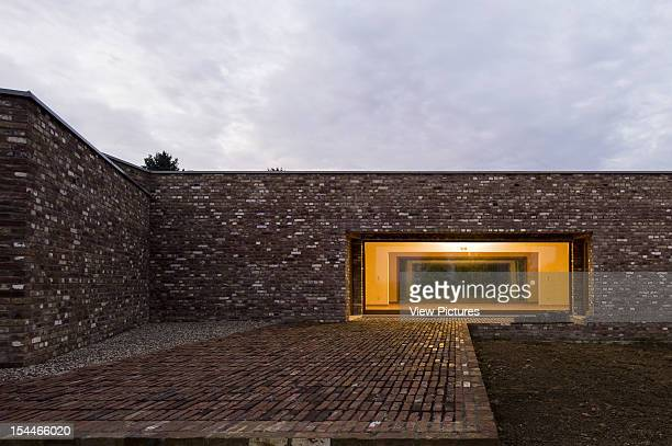 Museum Insel Hombroich Alvaro Siza Rudolf Finsterwalder Neuss 2008 Detail Of Exterior Facade With Brick Wall Brick Pavement And Illuminated Courtyard...
