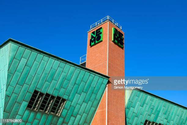 nemo museum is a science centre in amsterdam - design occupation stock pictures, royalty-free photos & images