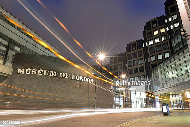 Museum of London captured at night while a road cleaning truck was passing by.